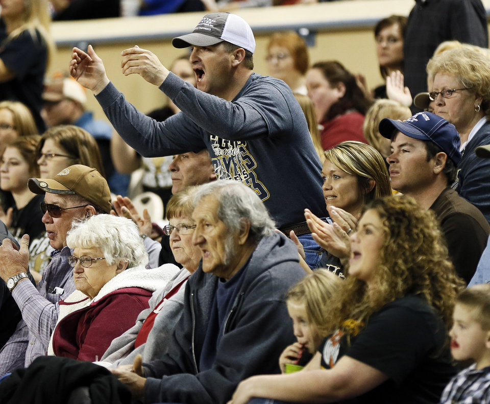 Photo - Moyers fans react during a Class B Boys first-round game of the state high school basketball tournament between Moyers and Big Pasture  at Jim Norick Arena, The Big House, on State Fair Park in Oklahoma City, Thursday, Feb. 28, 2013. Big Pasture won, 66-64. Photo by Nate Billings, The Oklahoman