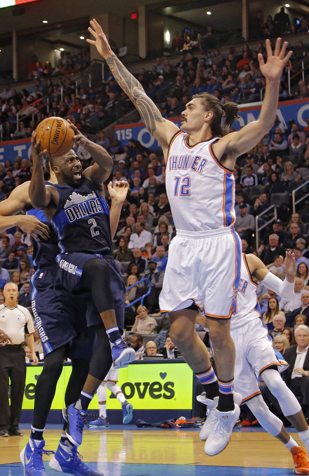 Photo - Oklahoma City's Steven Adams (12) tries to block a shot by Dallas' Raymond Felton (2) during the NBA basketball game between the Oklahoma City Thunder and the Dallas Mavericks at Chesapeake Energy Arena on Wednesday, Jan. 13, 2016, in Oklahoma City, Okla.  Photo by Chris Landsberger, The Oklahoman