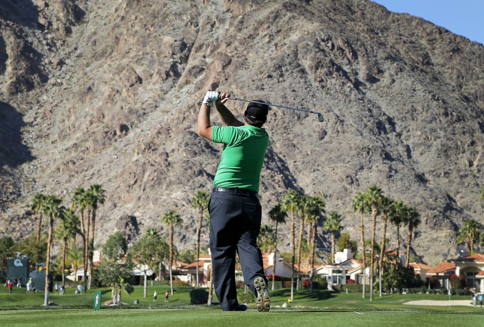 Photo - Patrick Reed hits from the fifth tee during the first round of the Humana Challenge PGA golf tournament on the Palmer Private course at PGA West, Thursday, Jan. 16, 2014, in La Quinta, Calif. (AP Photo/Matt York)