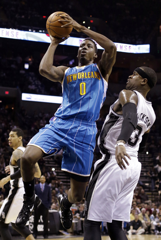 New Orleans Hornets' Al-Farouq Aminu (0) shoots over San Antonio Spurs' Stephen Jackson (3) during the first quarter of an NBA basketball game, Wednesday, Jan. 23, 2013, in San Antonio. (AP Photo/Eric Gay)