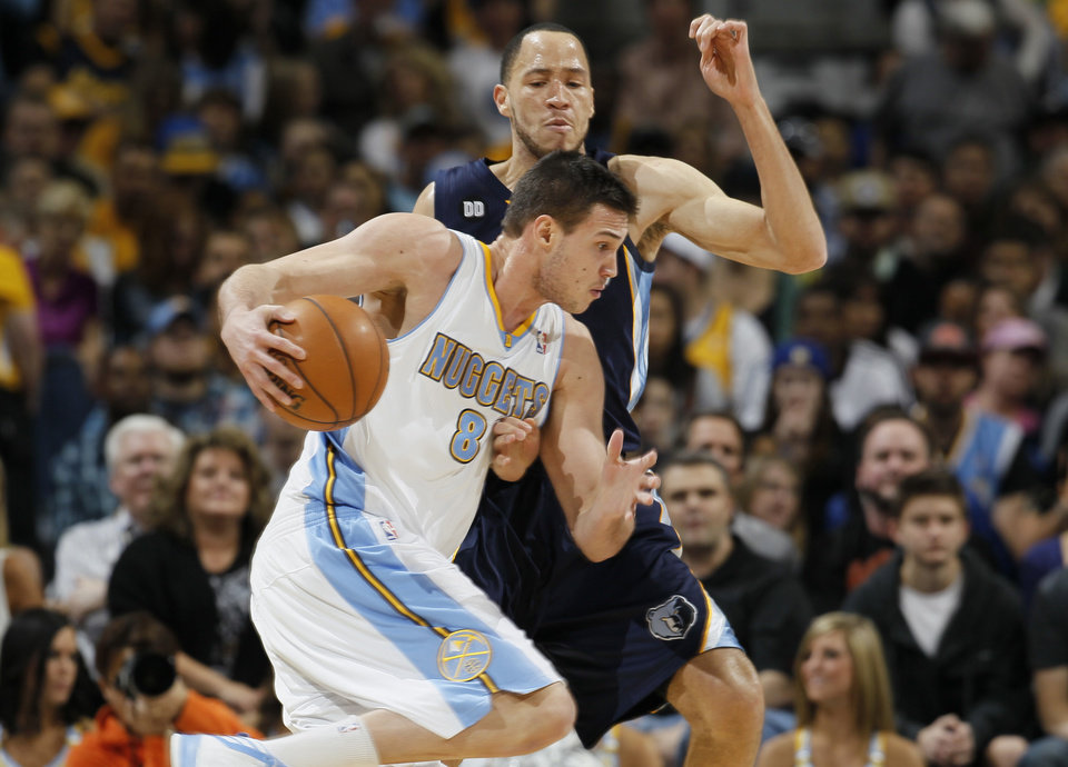 Photo - Denver Nuggets forward Danilo Gallinari, front, of Italy, works ball inside as Memphis Grizzlies forward Tayshaun Prince covers in the first quarter of an NBA basketball game in Denver, Friday, March 15, 2013. (AP Photo/David Zalubowski)