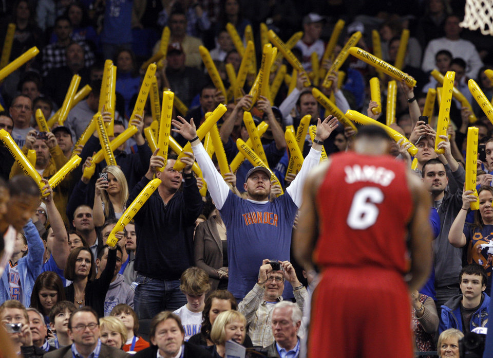 Fans try to distract Miami\'s LeBron James (6) as he shoots a free throw during the NBA basketball game between Oklahoma City and Miami at the OKC Arena in Oklahoma City, Thursday, Jan. 30, 2011. Photo by Sarah Phipps, The Oklahoman