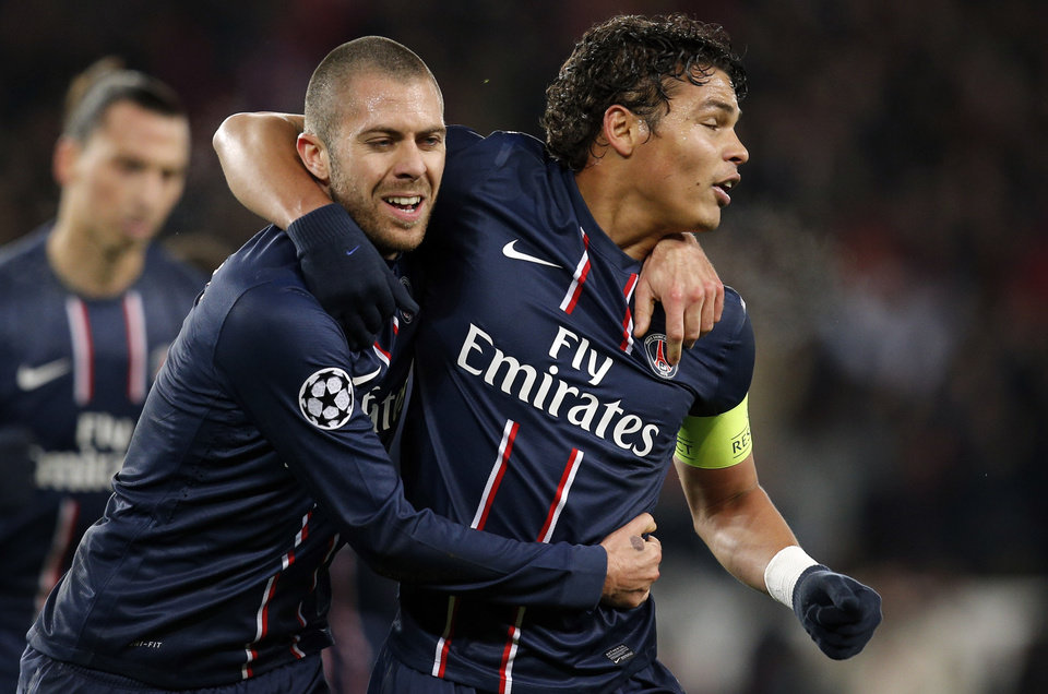 Paris Saint-Germain\'s Jeremy Menez, left, and teammate Thiago Silva celebrate a goal against FC Porto during their Champions League soccer match at the Parc des Princes stadium, in Paris, Tuesday, Dec. 4, 2012. (AP Photo/Christophe Ena)
