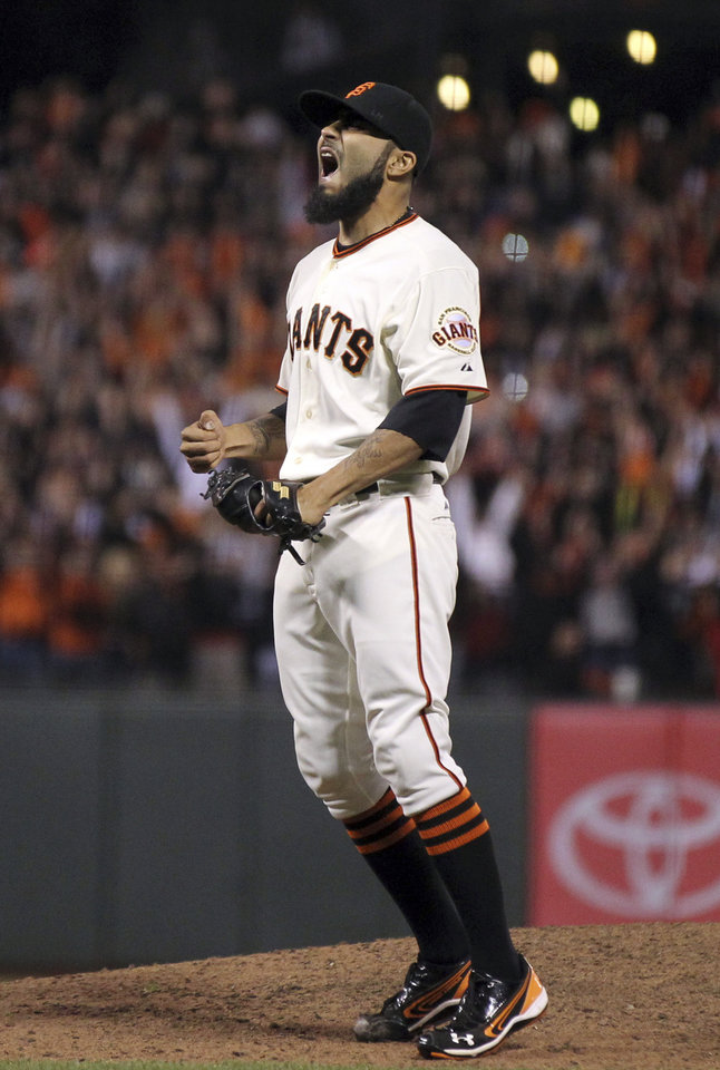 Photo -   San Francisco Giants' Sergio Romo celebrates the final out by the San Diego Padres in a baseball game Saturday, Sept. 22, 2012, in San Francisco. The Giants won 8-4, and captured the NL West title. (AP Photo/San Francisco Chronicle, Lance Iversen) MANDATORY CREDIT MAGS OUT NO SALES TV OUT