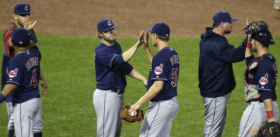 Photo - Cleveland Indians relief pitcher Scott Barnes (51) is congratulated by Mark Reynolds after defeating the Boston Red Sox in a baseball game at Fenway Park in Boston, Thursday, May 23, 2013. The Indians won 12-3. (AP Photo/Charles Krupa)