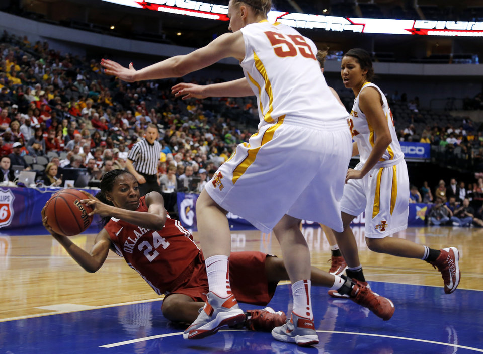 Oklahoma\'s Sharane Campbell (24) tries to pass the ball under Iowa State\'s Anna Prins (55) during the Big 12 tournament women\'s college basketball game between the University of Oklahoma and Iowa State University at American Airlines Arena in Dallas, Sunday, March 10, 2012. Oklahoma lost 79-60. Photo by Bryan Terry, The Oklahoman