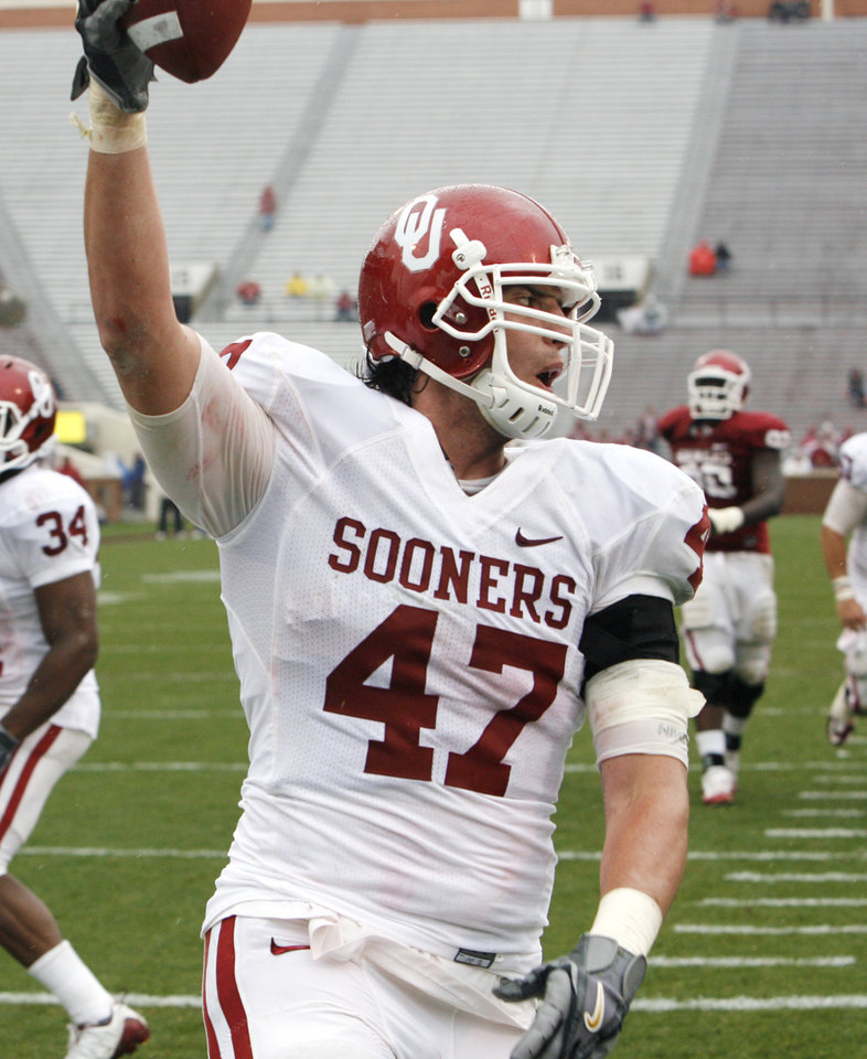 Photo - Trent Ratterree (47) celebrates a touchdown pass during the spring Red and White football game for the University of Oklahoma (OU) Sooners at Gaylord Family/Oklahoma Memorial Stadium on Saturday, April 17, 2010, in Norman, Okla.  Photo by Steve Sisney, The Oklahoman