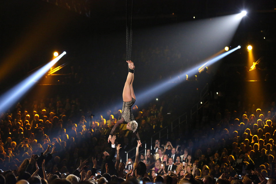 Photo - Pink performs at the 56th annual Grammy Awards at Staples Center on Sunday, Jan. 26, 2014, in Los Angeles. (Photo by Matt Sayles/Invision/AP)