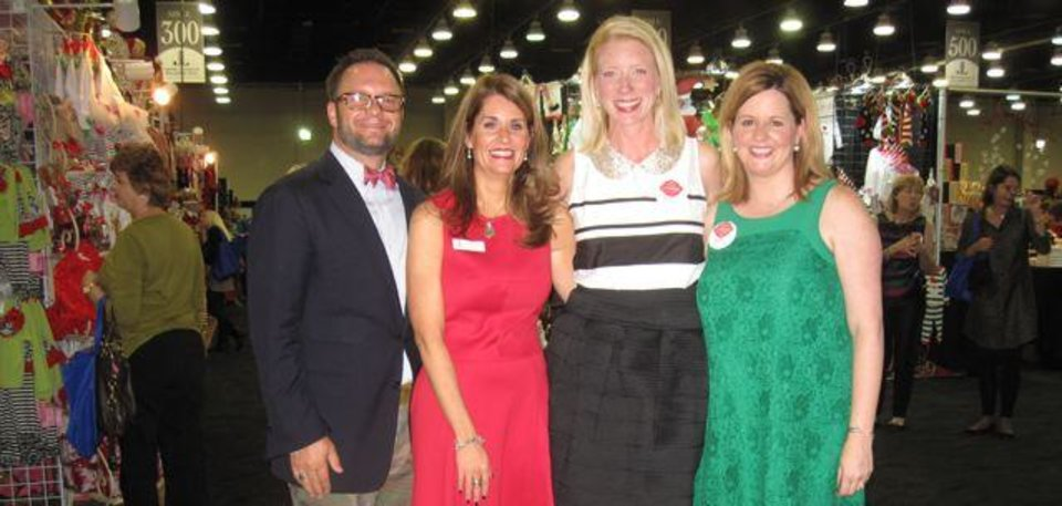 Matt and Kristsen Brown, Shannon Love and Amy Parrish were at the Junior League Mistletoe Market Preview Party. (Photo by Helen Ford Wallace).