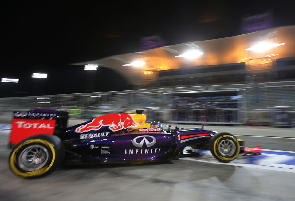 Photo - Red Bull driver Sebastian Vettel of Germany leaves the garage during the second practice session of the Bahrain Formula One Grand Prix at the Formula One Bahrain International Circuit in Sakhir, Bahrain, Friday, April 4, 2014. The Bahrain Formula One Grand Prix will take place here on Sunday. (AP Photo/Kamran Jebreili)
