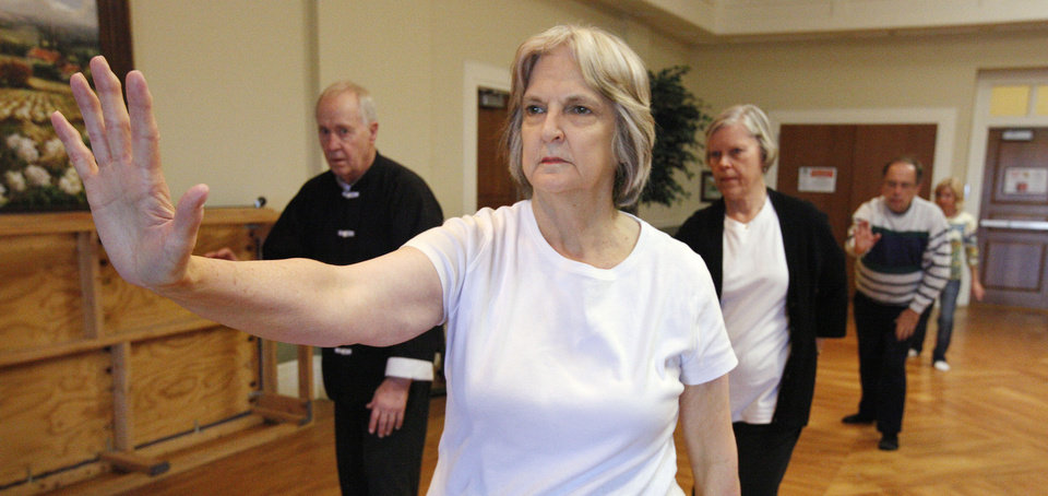 Photo - Sue Hite, Edmond, participates in a tai chi class at the Edmond Senior Center. Classes are on Mondays and Fridays. PHOTO BY PAUL B. SOUTHERLAND, THE OKLAHOMAN.  PAUL B. SOUTHERLAND - THE OKLAHOMAN