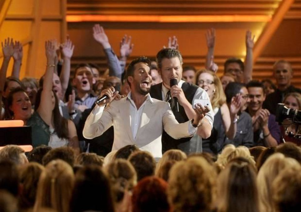 Photo -  Luke Bryan, left, and Blake Shelton take a selfie in the audience at the 49th annual Academy of Country Music Awards at the MGM Grand Garden Arena on Sunday, April 6, 2014, in Las Vegas. (AP)