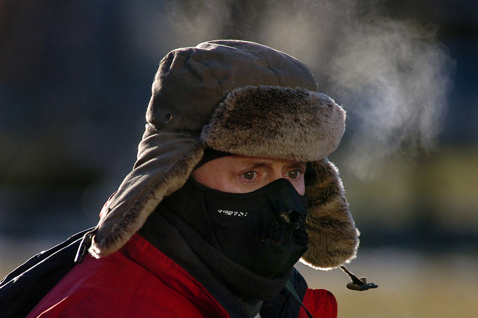 Photo - Jeffrey Campbell of Scranton, Pa. braves the cold weather on Tuesday, Jan. 7, 2014 in downtown Scranton Dangerously cold polar air snapped decades-old records as it spread Tuesday from the Midwest to southern and eastern parts of the U.S. and eastern Canada, making it hazardous to venture outside and keeping many schools and businesses closed.  (AP photo / The Scranton Times-Tribune, Butch Comegys)  MANDATORY CREDIT