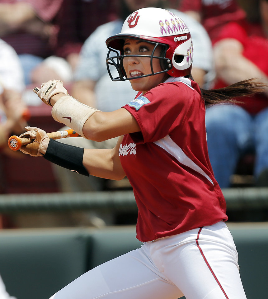 Photo - OU's Destinee Martinez (00) drives in three runs in the 2nd inning during the final game of the Norman Regional in 2014 NCAA softball championship between Oklahoma and Texas A&M in Norman, Okla., Sunday, May 18, 2014. OU won 11-6. Photo by Nate Billings, The Oklahoman