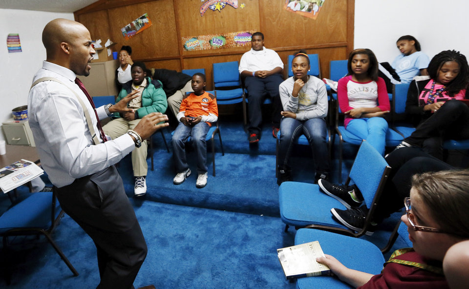 Photo - Pastor DeWayne Walker leads middle-school children in a discussion during J.A.M. Youth Ministry at Prospect Baptist Church, 2809 N Missouri Ave., in Oklahoma City, Wednesday, Nov. 14, 2012. Photo by Nate Billings, The Oklahoman