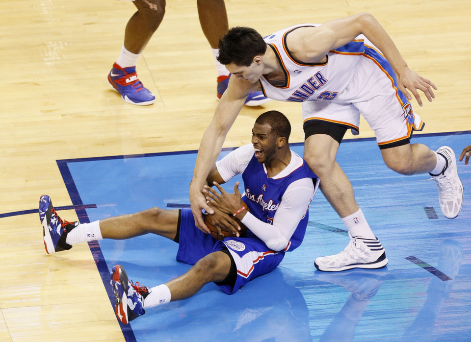 Chris Paul (3) calls time out after falling as Steven Adams (12) comes over to try and tie during Game 5 of the Western Conference semifinals in the NBA playoffs between the Oklahoma City Thunder and the Los Angeles Clippers at Chesapeake Energy Arena in Oklahoma City, Tuesday, May 13, 2014. Photo by Bryan Terry, The Oklahoman