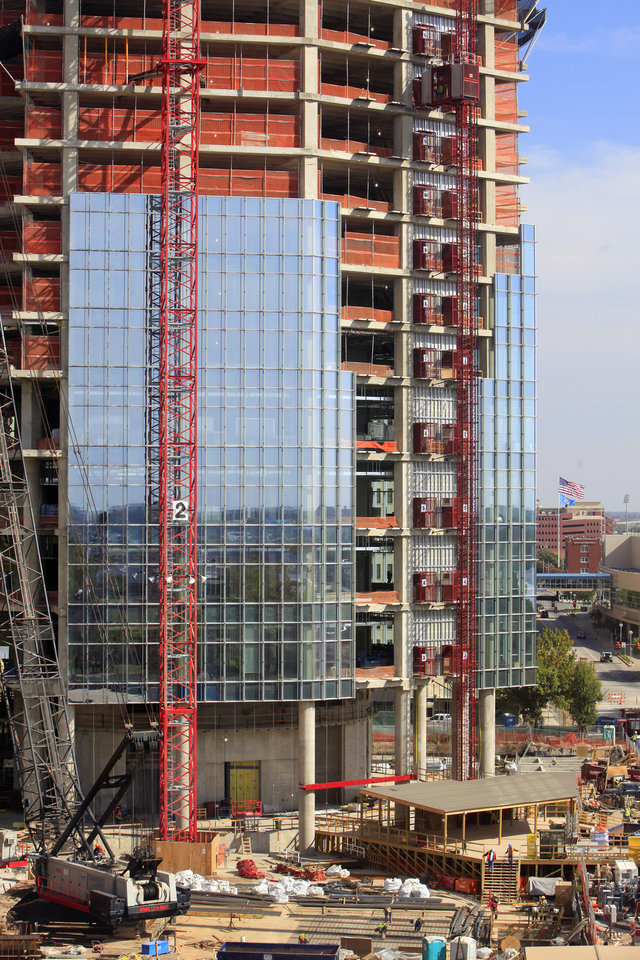 Construction is shown at the base of the Devon  tower.