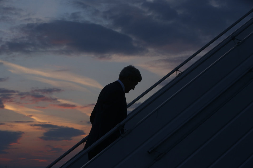 Photo - AP10ThingsToSee - U.S. Secretary of State John Kerry boards his plane in Paris, as he returns to Washington, Saturday, July 26, 2014, following efforts to reach a longer truce between Israel and Hamas in Gaza. (AP Photo/Charles Dharapak, Pool)