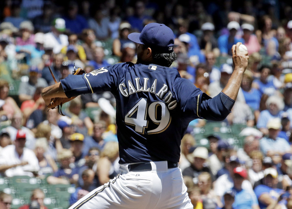 Photo - Milwaukee Brewers starting pitcher Yovani Gallardo throws during the first inning of a baseball game against the Colorado Rockies Sunday, June 29, 2014, in Milwaukee. (AP Photo/Morry Gash)
