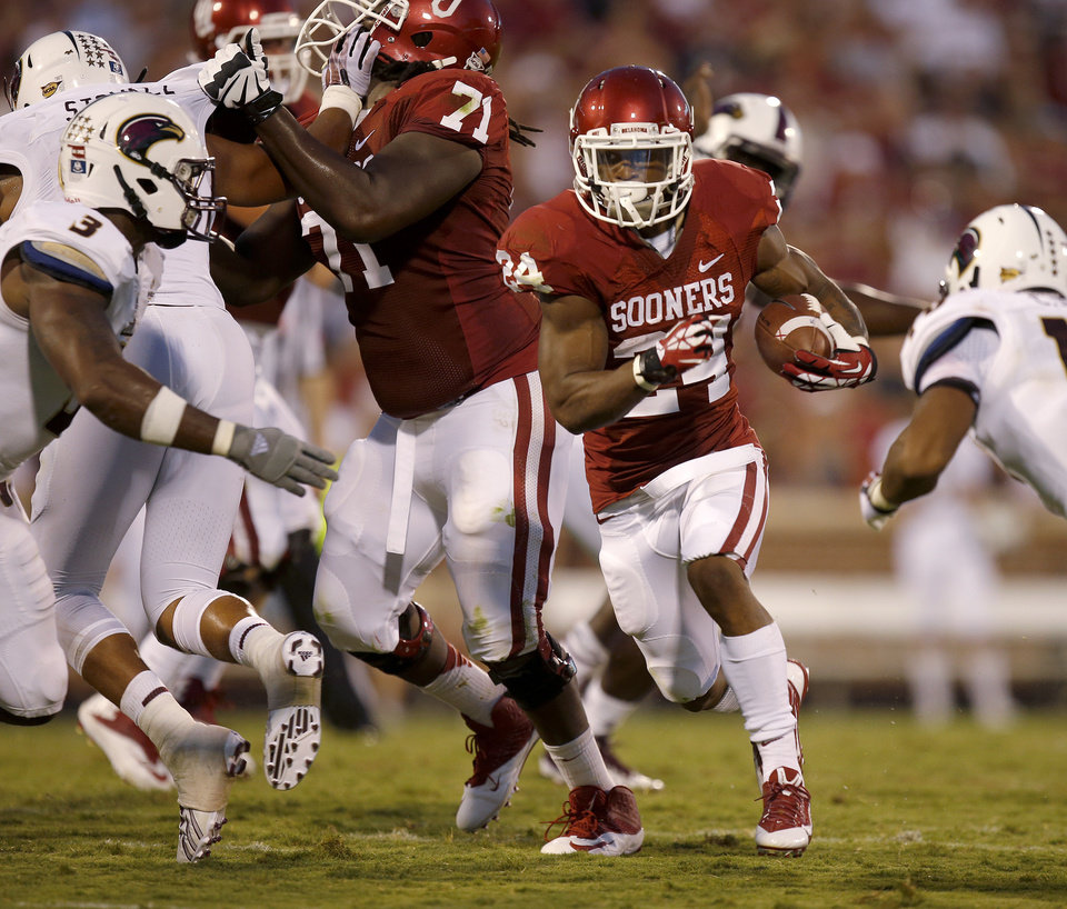 Photo - Oklahoma's Brennan Clay runs during a college football game between the University of Oklahoma Sooners (OU) and the University of Louisiana Monroe Warhawks at Gaylord Family-Oklahoma Memorial Stadium in Norman, Okla., on Saturday, Aug. 31, 2013. Oklahoma won 34-0. Photo by Bryan Terry The Oklahoman