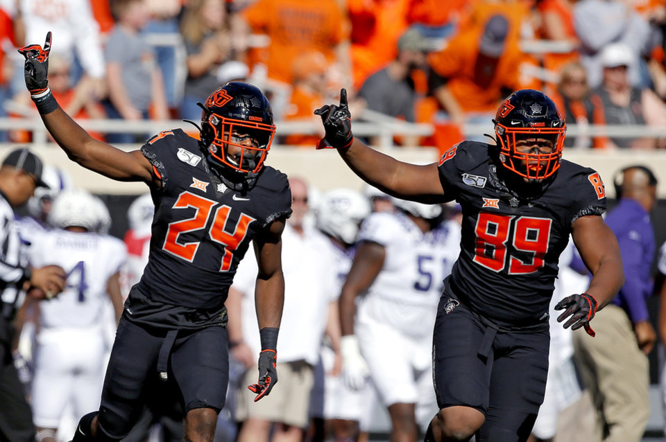 Photo - Oklahoma State's Jarrick Bernard (24) and Oklahoma State's Tyler Lacy (89)