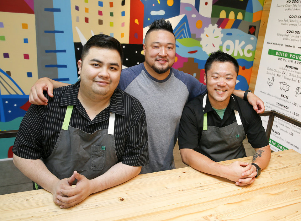 Photo -  From left, general manager Danh Do, chef Kevin Lee and assistant general manager Dan Johnson at Gogi Go, a Korean fast-casual concept at 1325 N Walker Ave., in Oklahoma City. [Photo by Nate Billings, The Oklahoman]