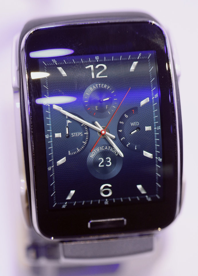 Photo - The display of a Samsung Gear S smart watch is pictured during an  'Unpacked event'  at the IFA, one of the world's largest trade fairs for consumer electronics and electrical home appliances in Berlin, Germany, Wednesday, Sept. 3, 2014. The IFA takes place in Berlin from Sept. 5 until Sept. 10, 2014. (AP Photo/Michael Sohn)
