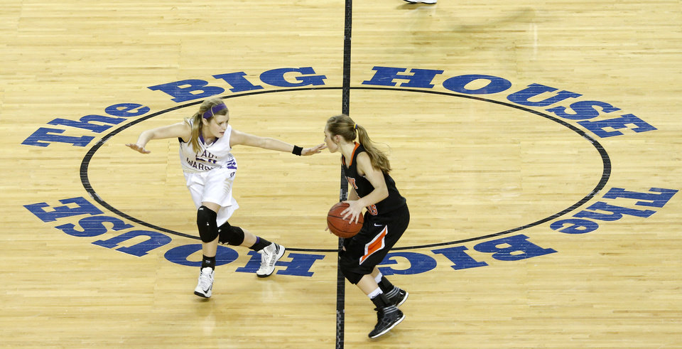 Photo - Okarche's Kenadey Grellner defends Cheyenne's Morgan Latta during the Class A girls state championship game between Okarche and Cheyenne/Reydon in the State Fair Arena at State Fair Park in Oklahoma City, Saturday, March 2, 2013. Photo by Bryan Terry, The Oklahoman