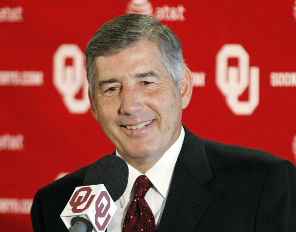 Big 12 Commissioner Bob Bowlsby smiles as he answers a question during an NCAA college football news conference in Norman, Okla., Monday, Aug. 27, 2012. (AP Photo/Sue Ogrocki) ORG XMIT: OKSO105