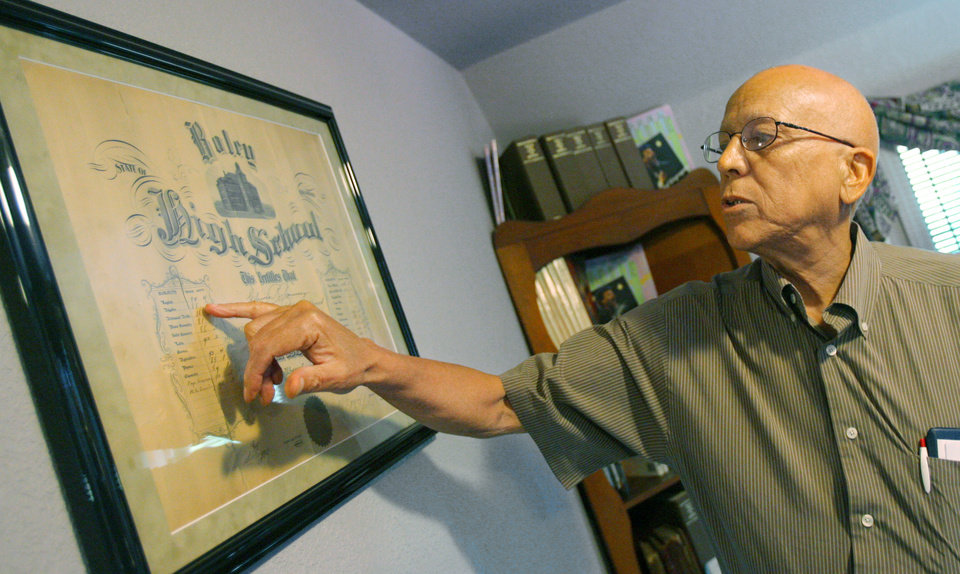 Maurice Lee Jr. shows off an old Boley High School diploma at the Boley historical house during a tour of the town by members of institute studying historically African American communities, in Boley, Okla., Wednesday, July 23, 2008. BY MATT STRASEN, THE OKLAHOMAN