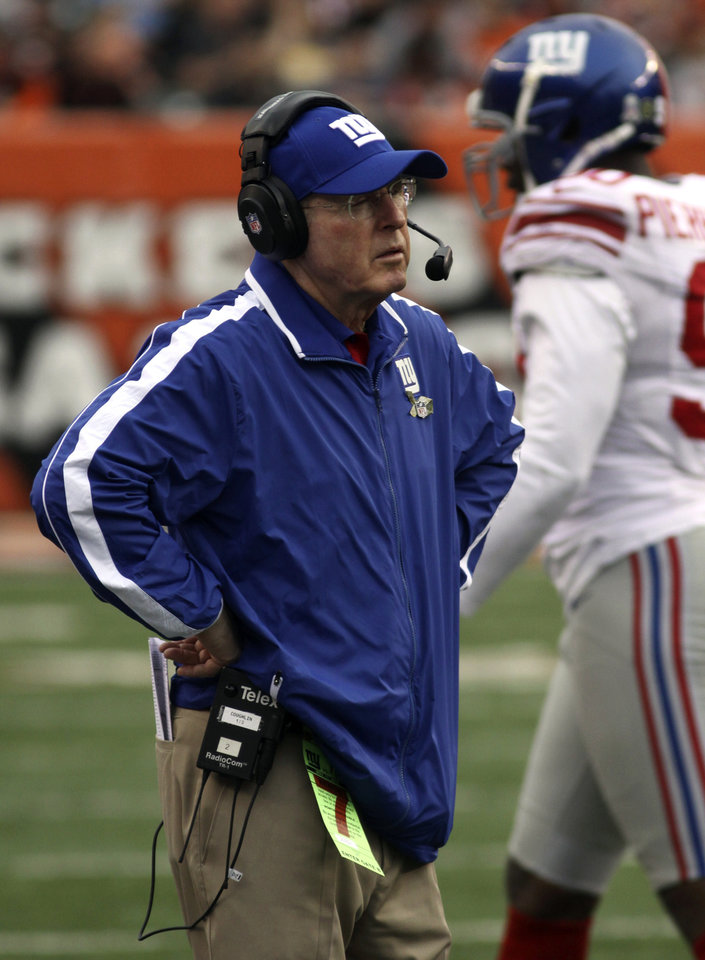 Photo -   New York Giants head coach Tom Coughlin stands on the sidelines in the second half of an NFL football game against the Cincinnati Bengals, Sunday, Nov. 11, 2012, in Cincinnati. Cincinnati won 31-13. (AP Photo/Tom Uhlman)