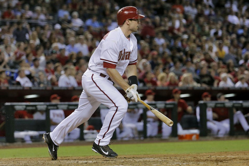 Photo - Arizona Diamondbacks' Paul Goldschmidt follows through on a base hit against the Cleveland Indians during the sixth inning of a baseball game, Tuesday, June 24, 2014, in Phoenix. (AP Photo/Matt York)
