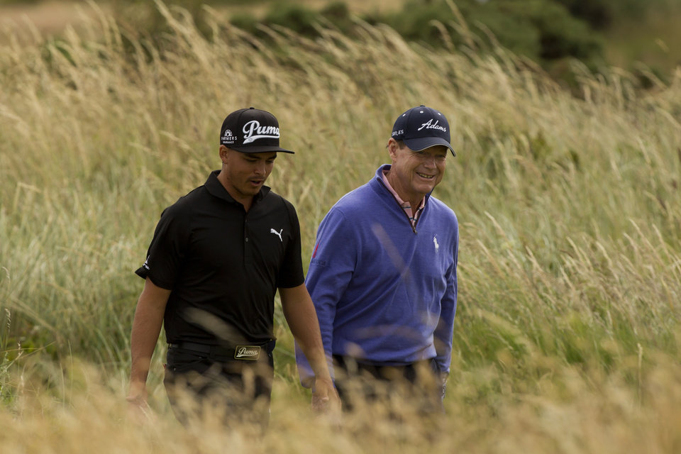 Photo - Tom Watson, right, and Rickie Fowler, both of the US walk down the 6th fairway during a practice round at Royal Liverpool Golf Club prior to the start of the British Open Golf Championship, in Hoylake, England, Monday, July 14, 2014. The 2014 Open Championship starts on Thursday, July 17. (AP Photo/Jon Super)