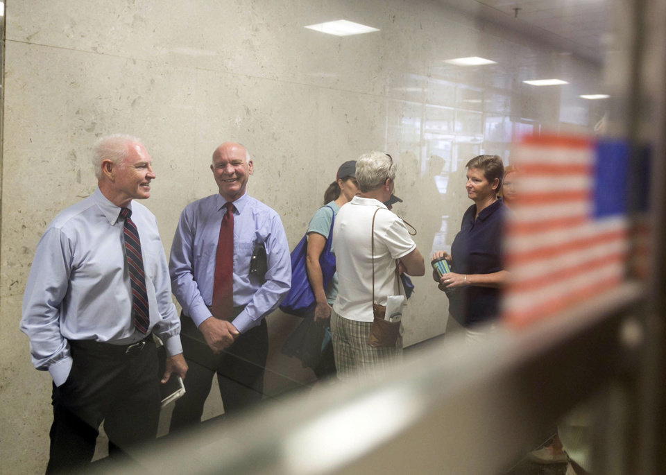 Photo - Kem Highfill, left, and Richard Rehm, both of Madison, are the first in line to get married at the county clerks office Saturday, June 7, 2014, in Madison, Wis. On Friday a federal judge struck down the state's gay marriage ban. (AP Photo/Andy Manis)