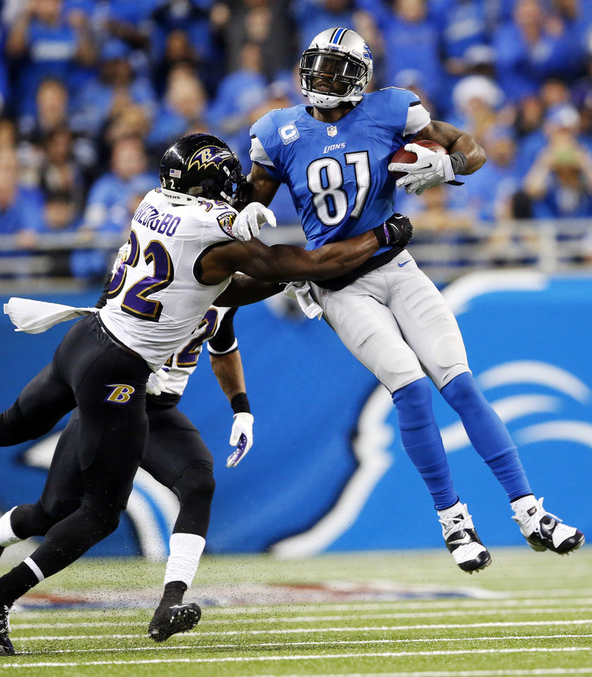 Photo - Baltimore Ravens strong safety James Ihedigbo (32) tackles Detroit Lions wide receiver Calvin Johnson (81) during the third quarter of an NFL football game in Detroit, Monday, Dec. 16, 2013. (AP Photo/Paul Sancya)