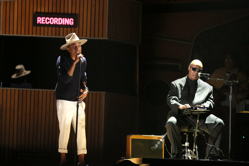 Photo - Pharrell Williams, left, and Stevie Wonder perform at the 56th annual Grammy Awards at Staples Center on Sunday, Jan. 26, 2014, in Los Angeles. (Photo by Matt Sayles/Invision/AP)