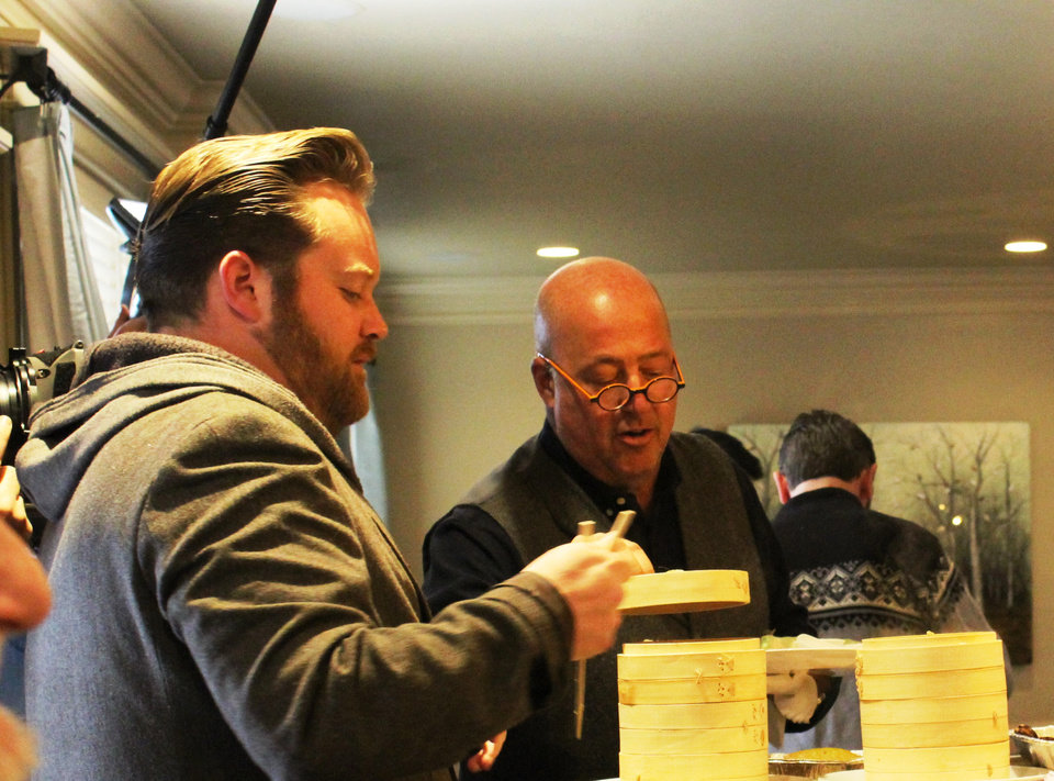 Photo -  Chef Russ Johnson, co-owner of Ludivine, chats with television host and chef Andrew Zimmern, who was in town filming segments for an episode of his
