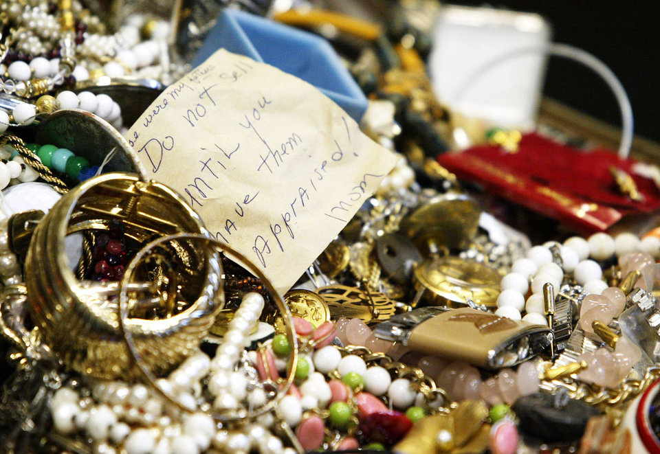 This Jan. 2, 2013 photo shows a pile of primarily costume jewelry among the mass of seized stolen goods during a news conference at Hudson Falls Village Court in Hudson Falls, N.Y. Few clues exist pointing to the owners of the roughly 30,000 items discovered after 39-year-old burglary suspect John Suddard�s recent arrest. So police are taking the novel step of displaying the items at the local high school Wednesday night, Jan. 9, 2013. (AP Photo/The Post-Star, Derek Pruitt)