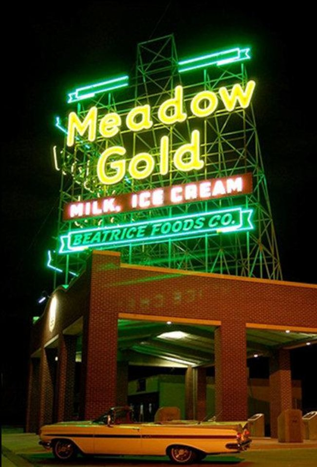 Photo - This restored neon Meadow Gold dairy products sign near 11th Street and Quaker Avenue in Tulsa provided a case study for the National Parks Service research of the economic impact of historic preservation along historic Route 66.   - PHOTO BY BRAD NICKSON PROVIDED B
