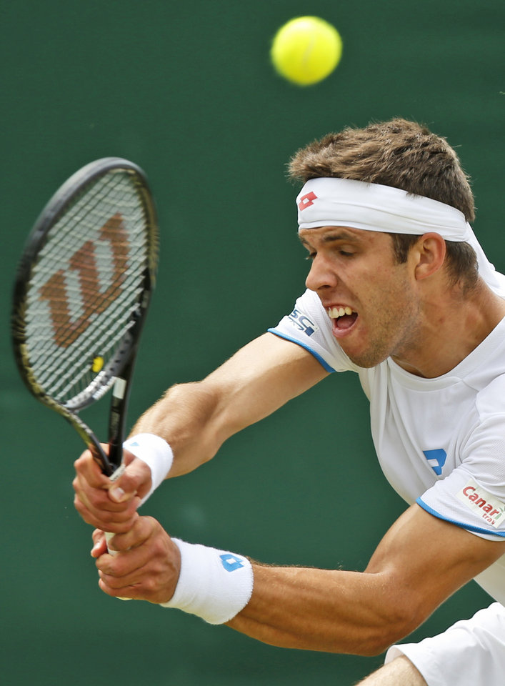 Photo - Jiri Vesely of the Czech Republic plays a return to Gael Monfils of France during their men's singles match at the All England Lawn Tennis Championships in Wimbledon, London, Thursday, June 26, 2014. (AP Photo/Sang Tan)