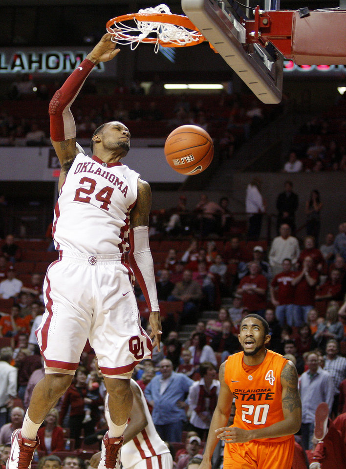 Oklahoma\'s Romero Osby (24) dunks the ball as Oklahoma State\'s Michael Cobbins watches during the Bedlam men\'s college basketball game between the University of Oklahoma Sooners and the Oklahoma State Cowboys in Norman, Okla., Wednesday, Feb. 22, 2012. Oklahoma won 77-64. Photo by Bryan Terry, The Oklahoman