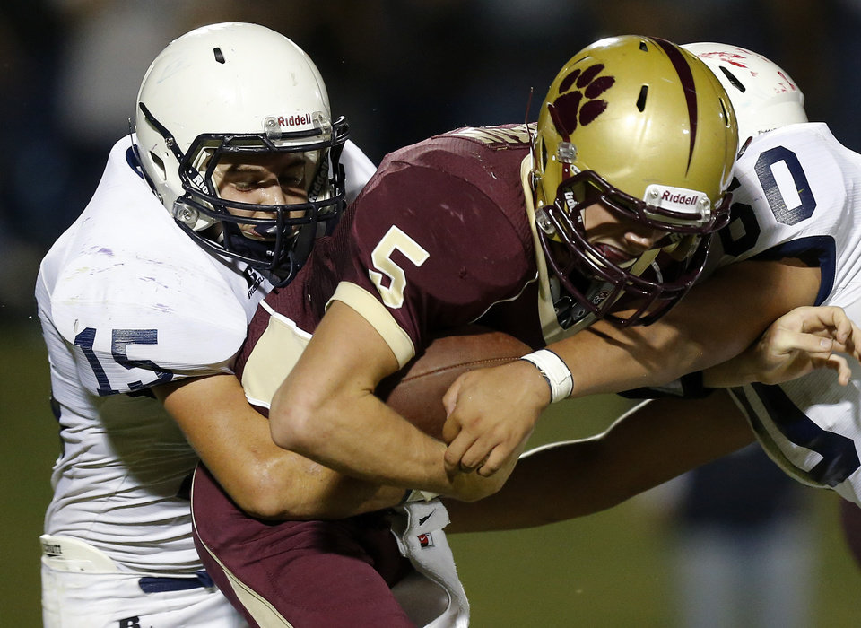Minco's Ringo Garrett brings down Cashion's Matt Harman during their high school football game in Cashion, Okla., Friday, Sept. 27, 2013. Photo by Bryan Terry, The Oklahoman