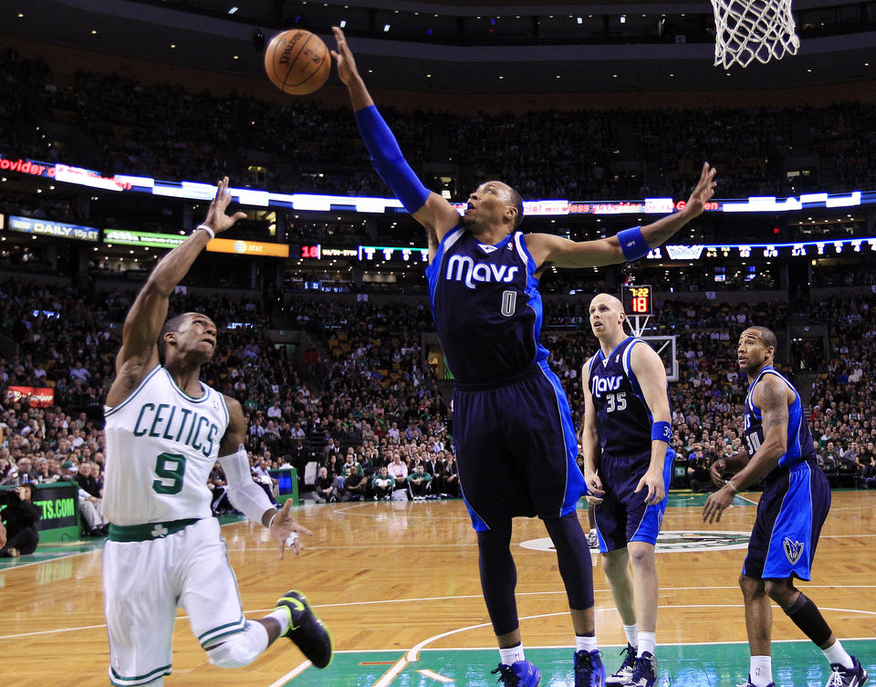 Dallas Mavericks forward Shawn Marion (0) blocks a shot by Boston Celtics guard Rajon Rondo (9) during the first quarter of an NBA basketball game in Boston, Wednesday, Dec. 12, 2012. (AP Photo/Elise Amendola)