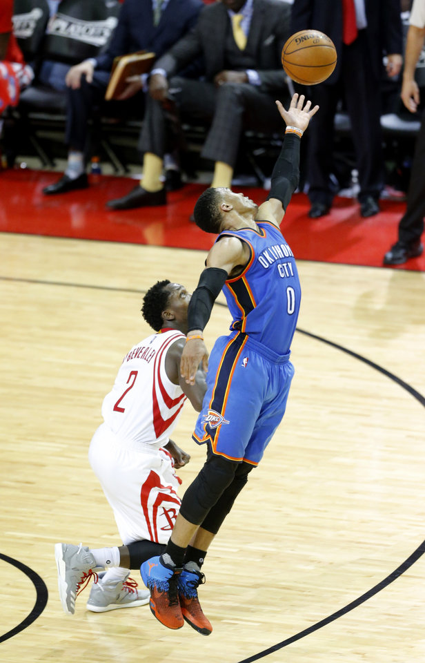 Photo - Oklahoma City's Russell Westbrook (0) gets a in bound pass as Houston's Patrick Beverley (2) defends during Game 5 in the first round of the NBA playoffs between the Oklahoma City Thunder and the Houston Rockets in Houston, Texas,  Tuesday, April 25, 2017.  Houston won 105-99. Photo by Sarah Phipps, The Oklahoman