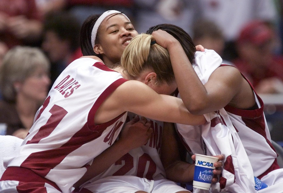 Photo - OU, NCAA TOURNAMENT: University of Oklahoma vs Duke University in the Final Four 2002 NCAA Women's College Basketball Tournament played at the Alamodome in San Antonio, Texas,  Friday March 29, 2002. Stacey Dales, LaNeishea Caufield and Rosalind Ross hug on bench toward the end of the game.  Staff photo by Doug Hoke.