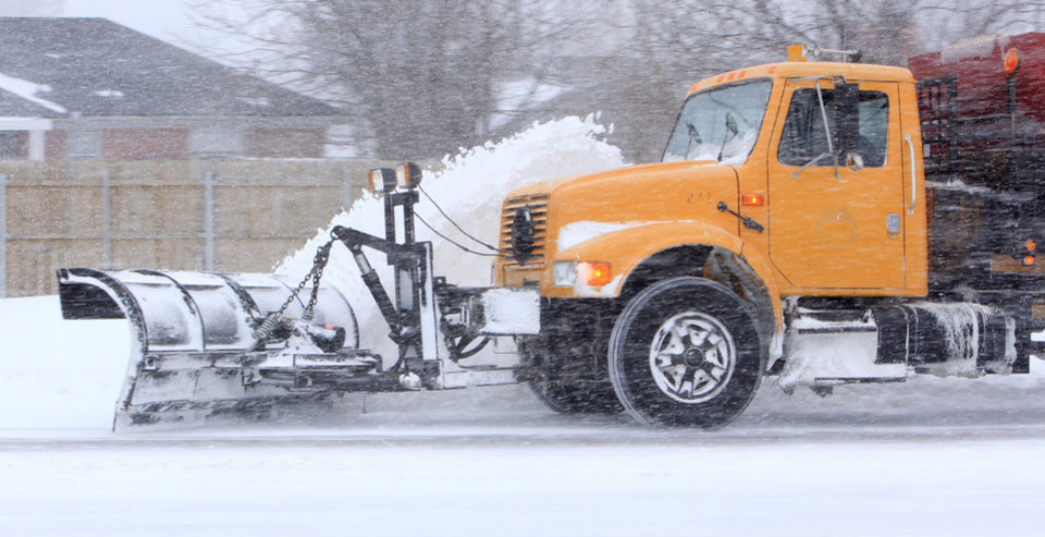 Photo - A snow plow moves along the NW Expressway in Oklahoma City Tuesday, Feb. 1, 2011.   Photo by Paul B. Southerland, The Oklahoman