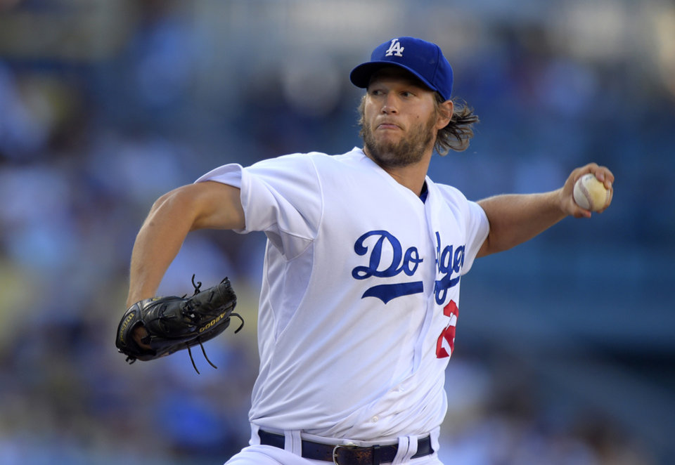 Photo - Los Angeles Dodgers starting pitcher Clayton Kershaw throws during the first inning of a baseball game against the Milwaukee Brewers, Saturday, Aug. 16, 2014, in Los Angeles. (AP Photo/Mark J. Terrill)