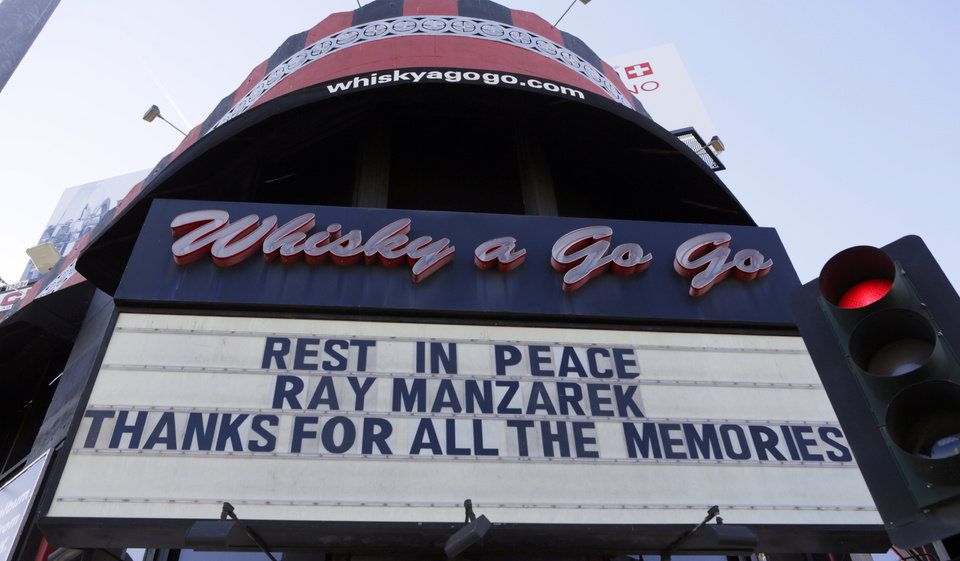 Photo - The Whisky a Go Go's marquee honors musician Ray Manzarek of The Doors Monday, May 20, 2013 in Los Angeles. Ray Manzarek, the keyboardist and founding member of The Doors who had a dramatic impact on rock 'n' roll, has died. He was 74. The Doors were the Whisky a Go Go opening band in 1966. (AP Photo/Damian Dovarganes)