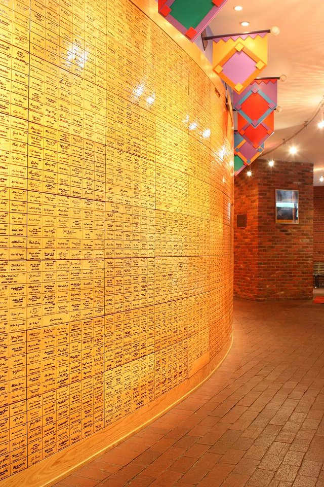 Photo - This undated image released by the Louisville Slugger Museum & Factory shows the signature wall at the museum in Louisville, Ky. Visitors can trace that baseball heritage along the Louisville Slugger Walk of Fame, stretching about a mile from the Louisville Slugger Museum & Factory to the city's minor-league ballpark. (AP Photo/Hillerich & Bradsby)