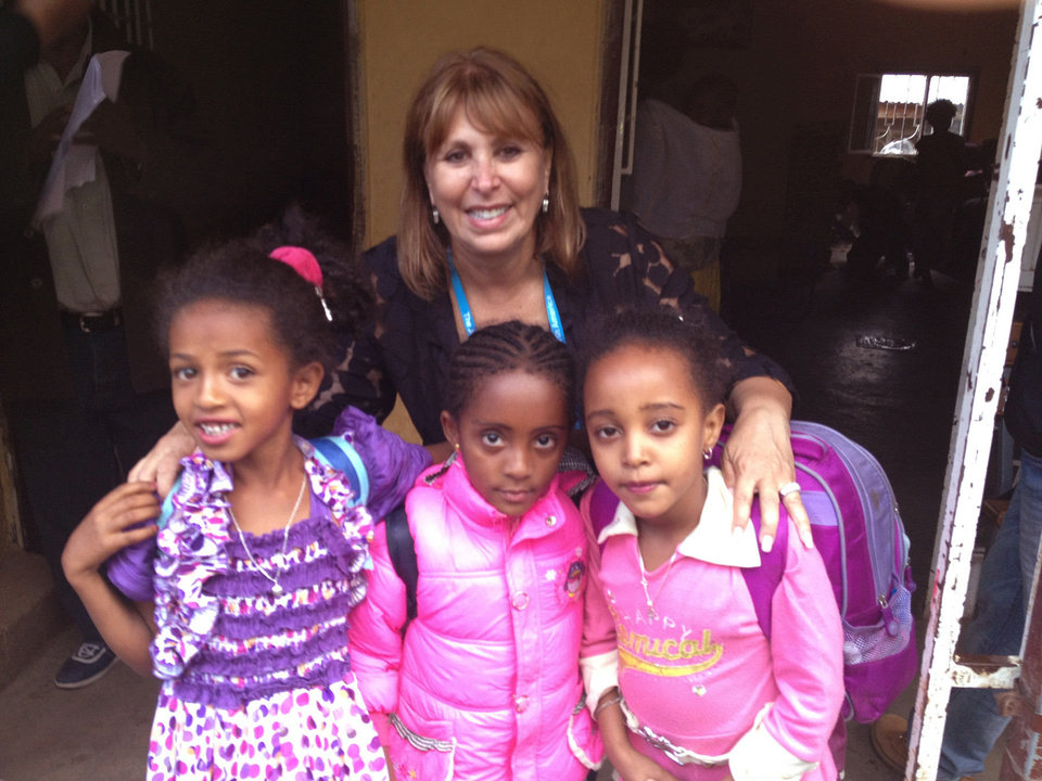 Photo - Edie Roodman, executive director of the Jewish Federation of Greater Oklahoma City, is pictured with three Ethiopian children she befriended during her recent trip to Ethopia and Israel. Photo provided